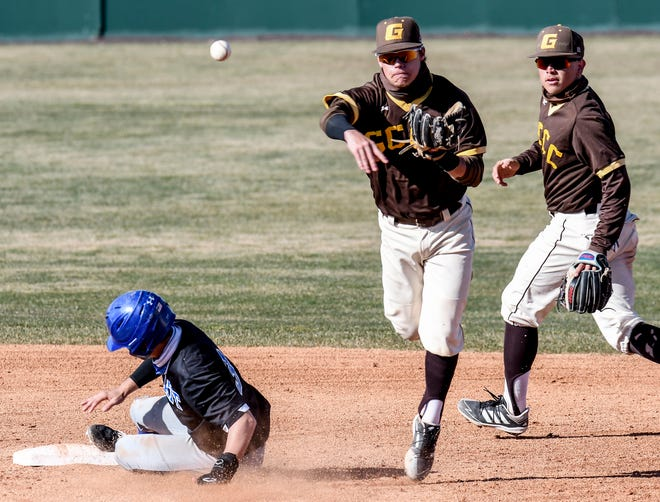 Garden City Community College shortstop Kyle Jameson, center, leaps to make a throw to first base to avoid the slide of Pratt's Cooper Bradbury as he turns a double play Friday during a doubleheader at Williams Stadium.  GCCC second baseman Ryan Muniz is shown at right.  The Broncbusters swept the Beavers on the day.