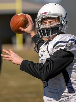 Monmouth-Roseville quarterback Silas Braun prepares to throw a pass during a drill at practice on Saturday, March 20, 2021.