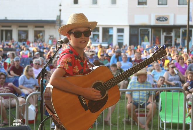 Sawyer Guymon entertains a crowd of concert goers at Music on Main 2019. Sawyer one of the artists who will perform during the 2021 concert series.