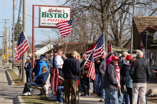 Supporters of Marlena Pavlos-Hackney, owner of Marlena's Bistro and Pizzeria, gather at her restaurant Monday, March 22, awaiting a news conference organized by local state Republican legislators.
