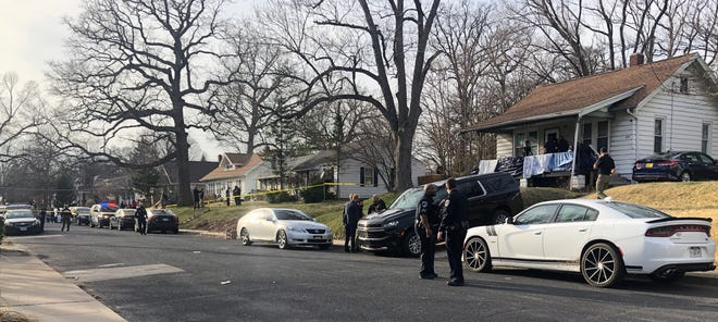 Police officers work at a home in the 400 block of West Willcox Avenue in Central Peoria, the site of a shooting on Monday, March 22, 2021.