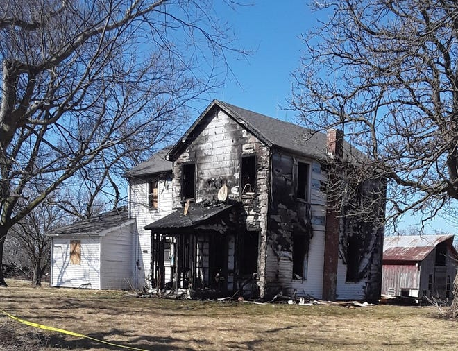 A Toluca man with a prior arson conviction has been charged again with that crime for allegedly setting fire to this long-vacant rural Toluca farmhouse, which was once the home of the late John and Mary Egleton and their 10 children. The structure is expected to be given to the Toluca-Rutland Fire Department for use in training.