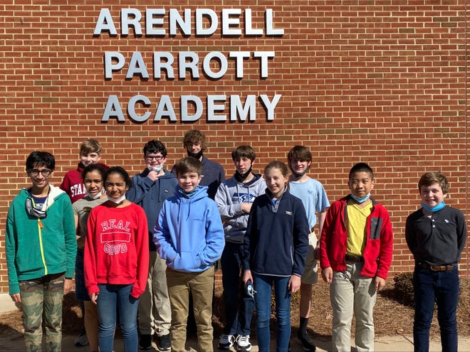 Ten Parrott Academy middle schoolers competed in the first ever virtual Chapter Competition on Friday, Feb. 5. Four of them had scores which qualified for the Chapter Competition held on Feb. 25. Allen Hutchinson, Brice Brodish, Winston Bates, and Carolina Jones all participated in the virtual tournament. Eighth grader Carolina Jones scored well enough to advance to State Competition on March 25. The team is coached by middle school math teacher Kelli Dawson. Pictured from left, Parrott Academy's MathCounts team: front row is Wali Omer, Preethi Chada, Edward Bates, Carolina Jones, Lucas Lin, Charles Harper; middle row is Arianna Aviles; back row is Winston Bates, Allen Hutchinson, Brice Brodish, Will Joyner. Standing in back is Ezra Zapler.