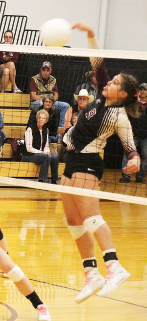 Swink High School's Edit Morales hits the ball over the net in a match against Hoehne in 2019.