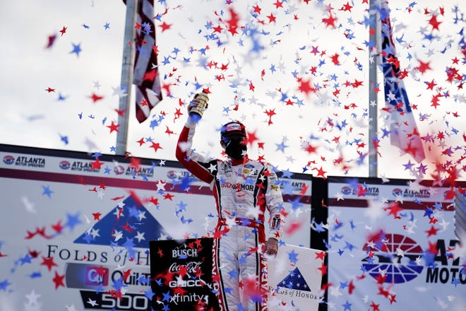 Ryan Blaney celebrates his win after a NASCAR Cup Series auto race at Atlanta Motor Speedway on Sunday, March 21, 2021, in Hampton, Ga.