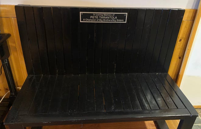 A bench in the Big Brothers Big Sisters office in the Newman Center dedicated to the memory of BBBS late program director PeteTarantola who passed away in October 2019. BBBS program director Sarah Baca said the bench will be installed in one of the Newman Center gardens at a later date.