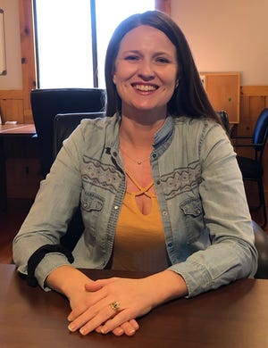 Big Brothers Big Sisters Program Director Sarah Baca sits in her office at the Newman Center on Friday. Baca said the mentoring program went through several changes from the death of PeteTarantola in October 2019 to their relocation to the Newman Center.