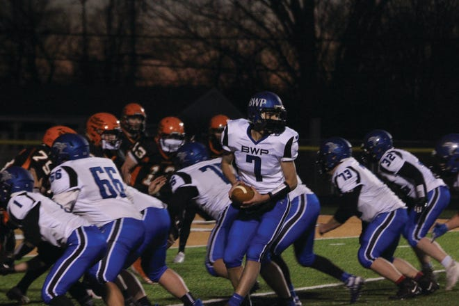 Sam Hensley looks to hand off the ball.