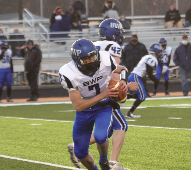 B/WP quarterback Sam Hensley runs the ball during Friday's game.