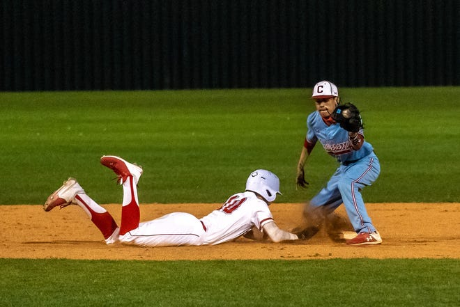 Heritage's Blake Wilhoite (10) slides safely into second base on a pick-off attempt during a recent HHS home game. The Jaguars swept a home-and-home series against Ferris last week with wins of 10-2 and 9-2.