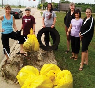 Community members participate during a previous Midlothian Spring Clean-Up Day along George Hopper Drive in this file photo. The latest Clean-Up Day has been set for April 10, the city has announced.