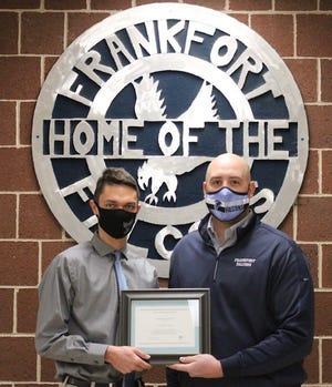 Christian Cimaglia is presented a Certificate of Merit from Frankfort principal Orie Pancione in recognition of being named a National Merit Scholarship Finalist.