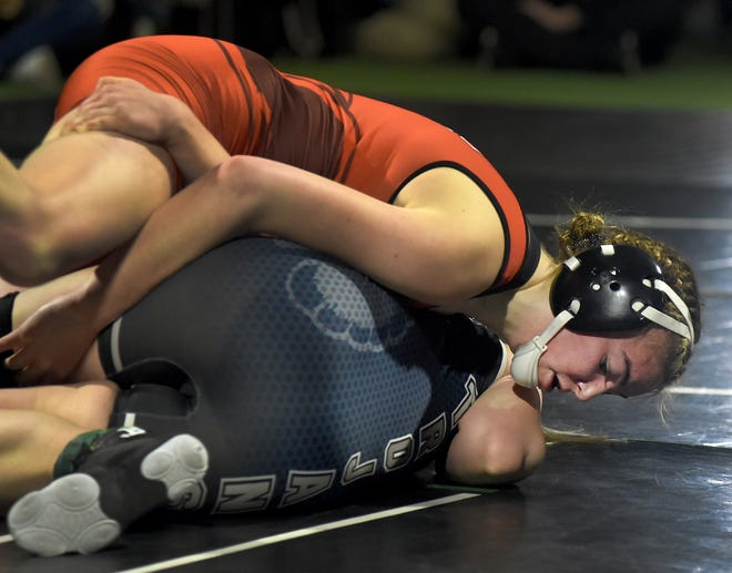 Taylor Randolph of Clinton works on pinning Isabel Worthing of East Jackson in the 138 pound championship match going onto pin her for the win of 2021 Michigan Wrestling Association High School Girls Championship held at Michigan Revolution in Highland, MI Sunday. [TOM HAWLEY/MONROE NEWS]