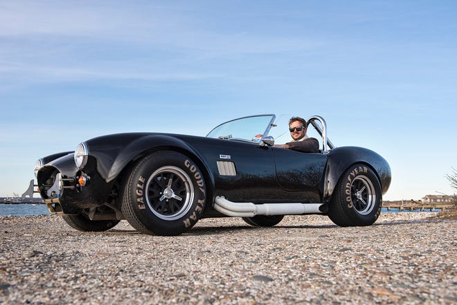 """Cody Helger takes a spin in the 1965 Shelby AC Cobra, his """"summer date-night machine."""""""