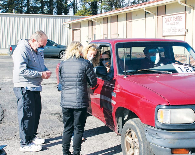 Free Medical Clinic of Oak Ridge, with help from volunteers, gives COVID-19 vaccines to members of the community who drive up ... or walk up for a shot.