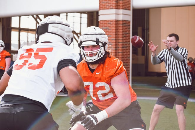 Oklahoma State offensive lineman Josh Sills (72) prepares to block defensive lineman Israel Antwine (95) during the Cowboys' first practice of the spring on Sunday at the Sherman Smith Center. [Courtesy of OSU Athletics]