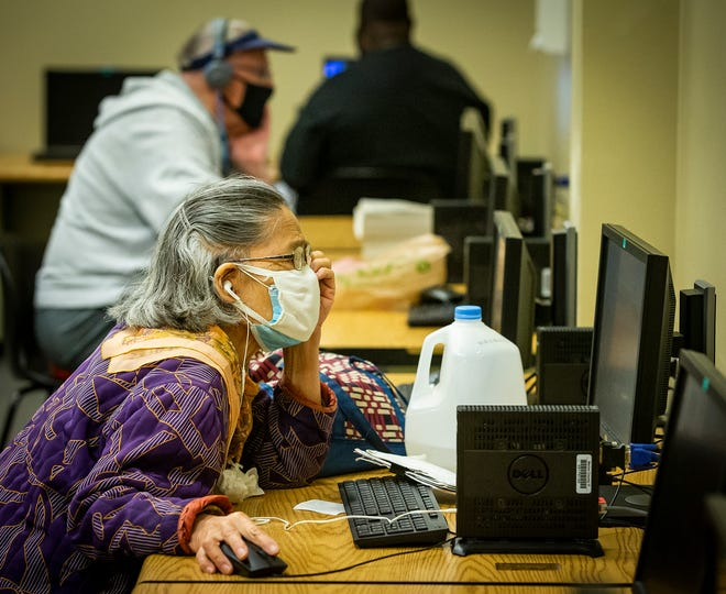 A patron uses one of the public computers at the Ocala Public Library's headquarters location on Monday. The library saved a good amount of money during the pandemic and is investing the savings back into computers.