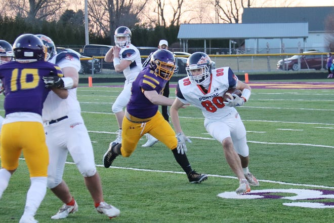 Pontiac's Kodi Davis tries to get around the end against Taylorville Friday. Davis rushed for 37 yards to lead the PTHS offense in a 40-0 loss.