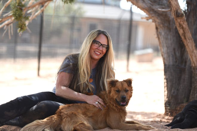 Julie Castle is the founder of Best Friends Animal Society. She is pictured with Finnegan, a rescue dog.
