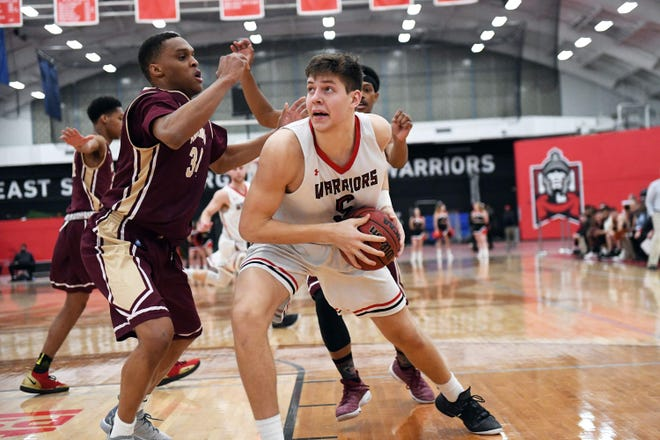 East Stroudsburg University's Ryan Smith splits the defense for a bucket during PSAC men's basketball in 2019. The ESU community rallied around the sophomore as he battled leukemia. Smith succumbed to his battle on Monday, March 22, 2021.