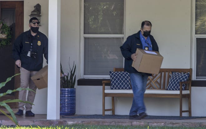 Authorities take pictures of former Florida state Sen. Frank Artiles' car as they raid his home in Palmetto Bay on Wednesday, March 17, 2021. (Pedro Portal/Miami Herald/TNS)
