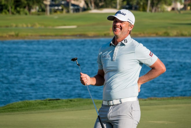 Matt Jones smiles as he reacts to the cheering crowd while approaching the 18th green Sunday during the final round of the Honda Classic at PGA National.  [ RICHARD GRAULICH/PALM BEACH POST]