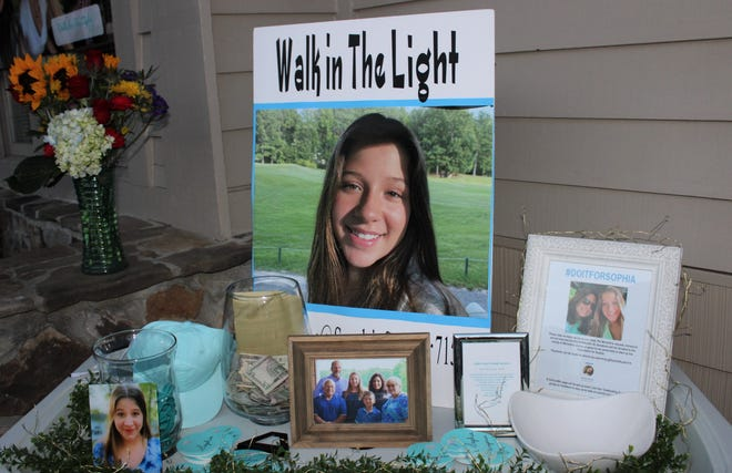 """A memorial on display at the 'Steps for Sophia' prayer walk in The Highlands of Chesterfield on March 12  to honor thirteen-year-old Sophia Studer who took her own life. Donations for bracelets, hats, and other items went towards the suicide prevention foundation """"Walk in the Light' initiated by Sophia's mother Michelle Studer."""