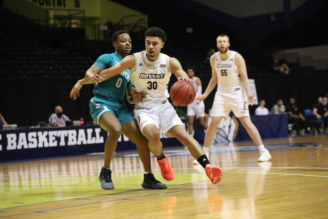 Bryant's Chris Childs gets around Coastal Carolina's Deanthony Tipler during the College Basketball Invitational on Monday in DaytonaBeach, Fla. Childs paced the Bulldogs with 24 points in the loss.