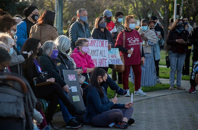 About 200 people attend the Candlelight Vigil for Asian Solidarity event held at Dr. Martin Luther King Jr. Plaza in downtown Stockton last Sunday.