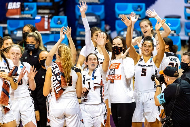 Oregon State celebrates a win over Florida State during a college basketball game in the first round of the women's NCAA tournament at the University Events Center in San Marcos, Texas, Sunday, March 21, 2021. (AP Photo/Stephen Spillman)