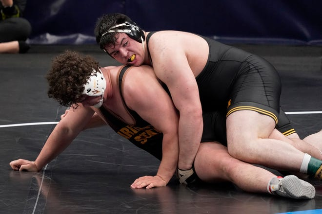 Iowa's Tony Cassioppi, right, a former Hononegah star, knocks off Arizona State's Cohlton Schultz in their 285-pound match in the quarterfinal round of the NCAA wrestling championships Friday, March 19, 2021, in St. Louis. Cassioppi went on to take third.