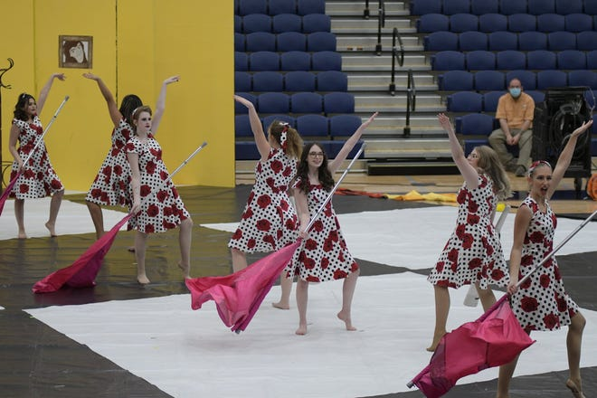 The Stephenville High School Yellow Jacket Band's WinterGuard performs during the Pre-UIL Concert held Thursday in the gym.