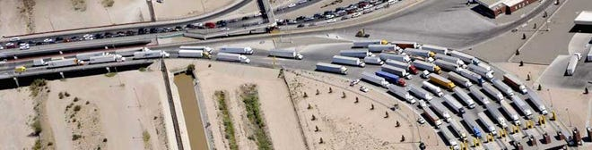 Trucks wait in line at the Texas-Mexico border.