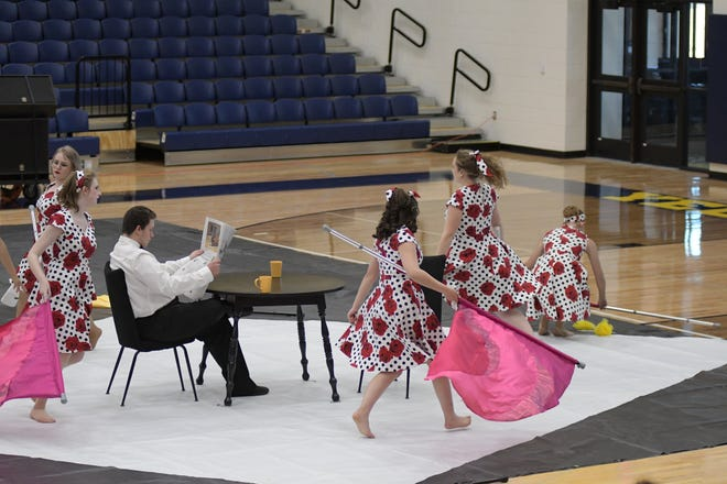 """The Stephenville High School Yellow Jacket Band's WinterGuard performs during the Pre-UIL Concert held Thursday in the gym. The WinterGuard performed in its first live competition of the season in Waxahachie this weekend and placed eighth with the 2021 production """"Settle Down.""""  The WinterGuard's final performance of the season will be at 1:45 Saturday at Mansfield High School."""
