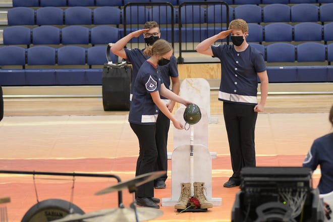 """The Stephenville High School Indoor drumline performs """"21 Guns,"""" a tribute to honoring the military during last Thursday's pre-UIL competition and hamburger supper in the SHS gym."""