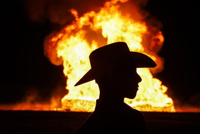 A TSU Texan is silhouetted at Friday's L.V. Risinger Memorial Bonfire.