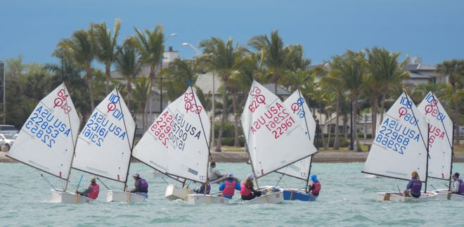 More than 130 young sailors, ages 9-14, took part in the  Optimist Team Race Midwinter Championships. hosted by the Sarasota Yacht Club on Sarasota Bay over the weekend.
