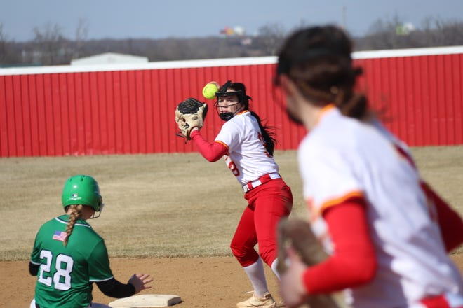 Dale shortstop Emilia Idleman, after stepping on second base, prepares to fire the ball to first baseman Anna Hester for a double-play attempt against Leedey Saturday.