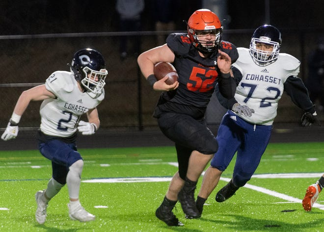 MHS defensive lineman Logan Verhaegen runs for a big gain after intercepting a Cohasset pass Friday night at Middleboro High School. The Sachems were 35-13 winners on the night, evening up at 1-1 on the season.