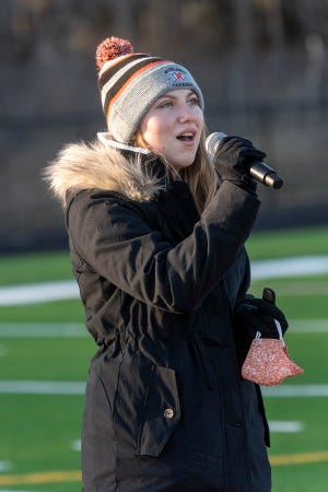 MHS student Cami Morano sings the National Anthem.