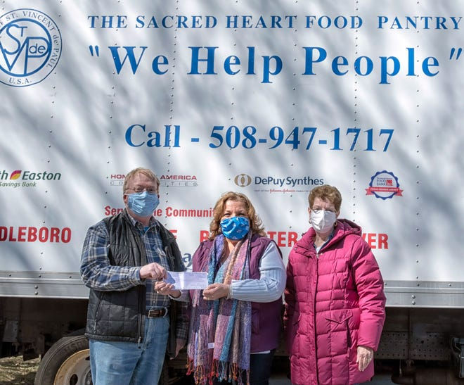 From left, David Cunningham, Director of the Sacred Heart Food Pantry, with Laurie LeFebvre and Flo Cadillac, representing the Middleboro Lodge of Elks.