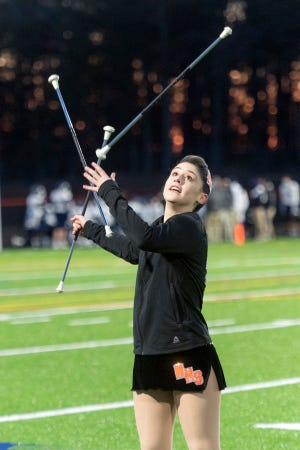 Middleboro High School Majorette Amanda Gisbert performs during the halftime show of Friday night's home football game against Cohasset.
