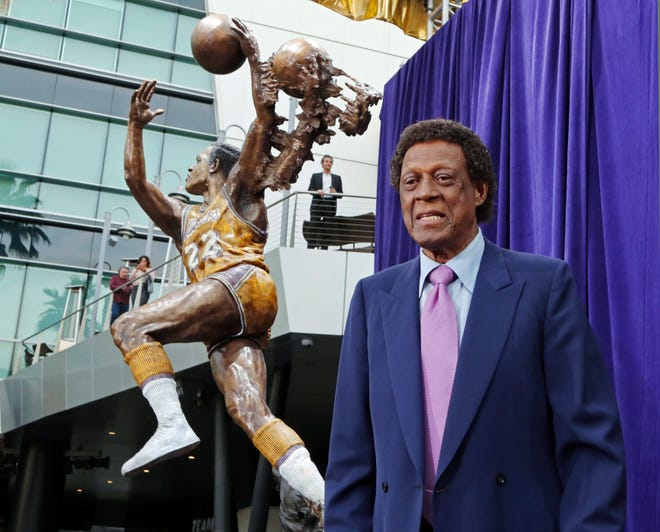 Elgin Baylor stands next to a statue, just unveiled, honoring the Minneapolis and Los Angeles Lakers great, outside Staples Center in Los Angeles, in this Friday, April 6, 2018, file photo. Baylor, the Lakers' 11-time NBA All-Star, died Monday, March 22, 2021, of natural causes. He was 86. The Lakers announced that Baylor died in Los Angeles with his wife, Elaine, and daughter Krystal by his side.