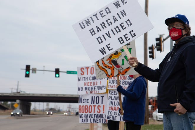 Union members hold signs across the street from Topeka's Frito-Lay plant at a picket earlier this year. Members of Local 218 of the Bakery, Confectionery, Tobacco Workers & Grain Millers Union voted to strike early next month.