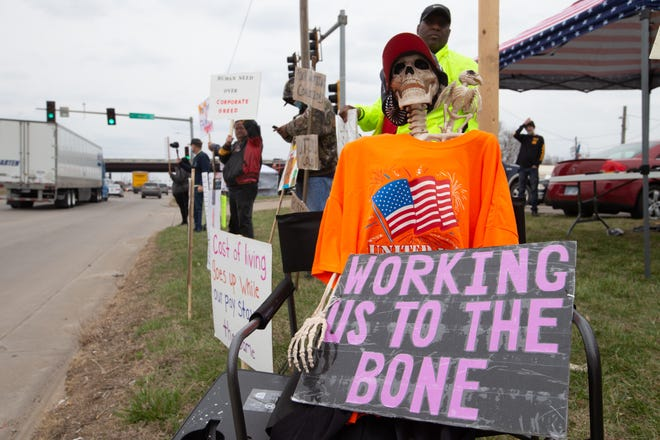 A skeleton is displayed along a line of picketers outside of the Frito-Lay plant, 4236 S.W. Kirklawn Ave., Monday afternoon ahead of mediated contract negotiations happening later this week.