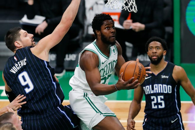 Boston's Semi Ojeleye looks to shoot in front of Orlando's Nikola Vucevic during Sunday's game.