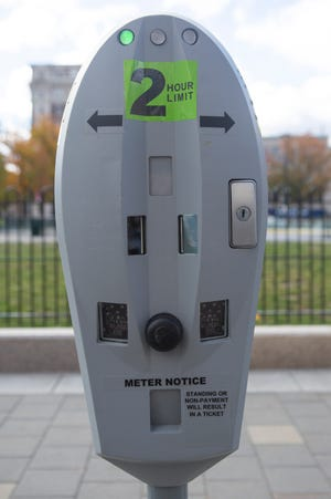 A so-called smart parking meter on Front Street in Worcester that was part of pilot program in the city four years ago. New multi-space parking meters to be installed will allow drivers to pay for parking with a cellphone app.