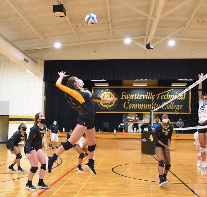 FTCC volleyball's Lauren Adams goes for a kill on March 16, 2021. [Photo by Brad Losh]