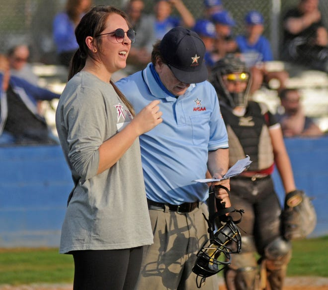 Gadsden City coach Claire Graves makes a substitution change during a high school softball game against Etowah in Attalla on Monday, March 22, 2021.