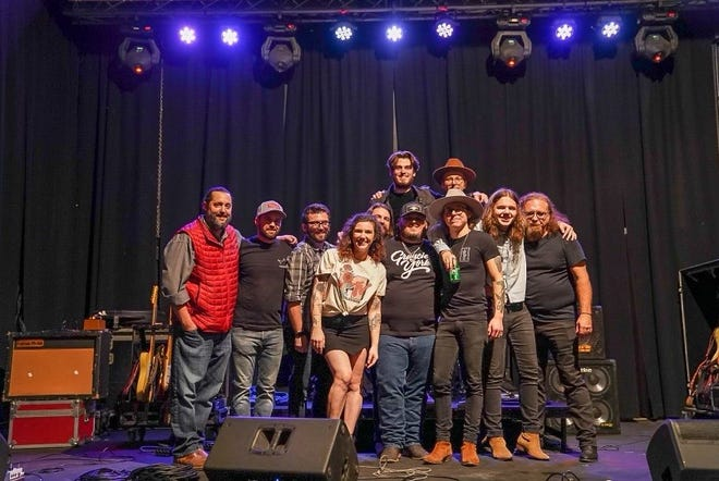 Directors of Peacemaker Festival, The Majestic and SŌL Studios take a picture with Tanner Usrey's band on Saturday, March 20, 2021, after their show at The Majestic in Fort Smith.
